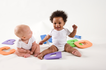 Infants playing with toys